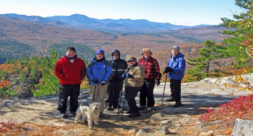OLLI Members on a mountain, surrounded by NH fall scenery